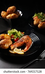 Low key salmon dish with potatoes and salad