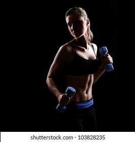 Low key silhouette of a fitness young woman