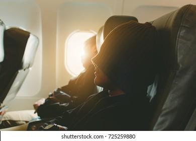 Low key, sleeping passenger in airplane,copy space.
