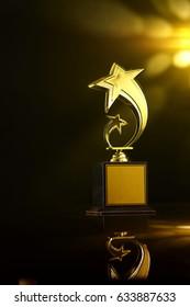 low key of trophy over dark background.