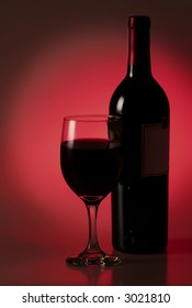 low key wine bottle and wine glass on red