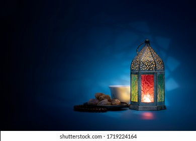 Low light photo of Lantern, Dates fruit and rosary for Ramadan and Eid greeting.