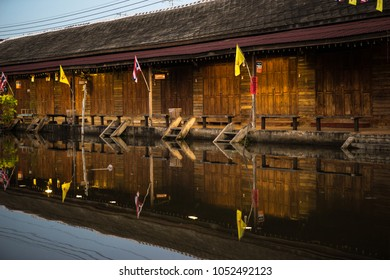 Low light picture of one storey wooden house on the  waterside with water reflection in famous tourist place,Samut Songkhram Province,Thailand.December-2015.