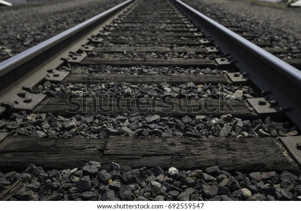 Low perspective of old wooden train tracks