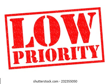 LOW PRIORITY red Rubber Stamp over a white background.