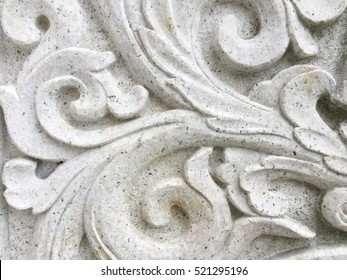 Low relief cement handcraft of flower