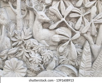 Low relief cement Thai style handcraft of flower stucco.