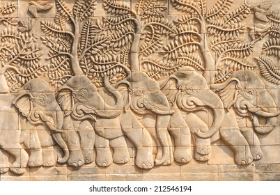 Low relief cement Thai style handcraft of elephant stories.