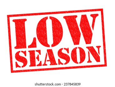 LOW SEASON red Rubber Stamp over a white background.