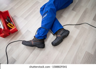 Low Section Of Male Electrician Wrapped In Wire Fallen On Floor