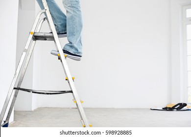 Low section of man on ladder