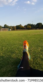 Low section of person sitting on soccer field