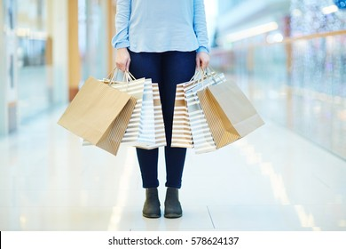 Low section of shopper with paperbags