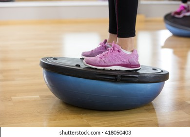 Low Section Of Woman Exercising On Bosu Ball