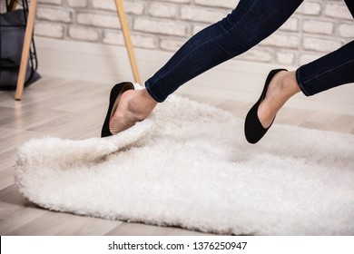Low Section Of Woman Stumble In A Carpet