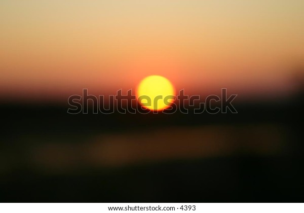 low setting sun over hills