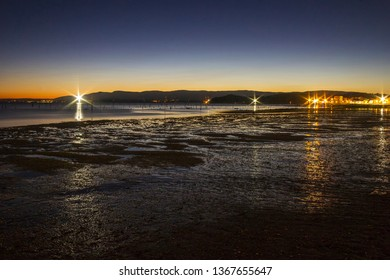 Low tide in Compostela beach, Vilagarcia de Arousa, at night