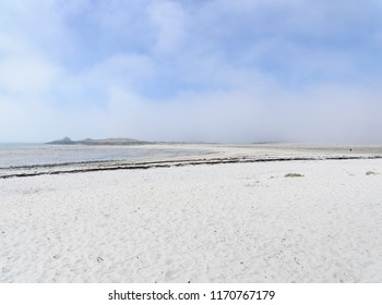 At low tide, in the early morning, sea mist starts to lift revealing small islands off Plage Sainte-Marguerite in Landeda