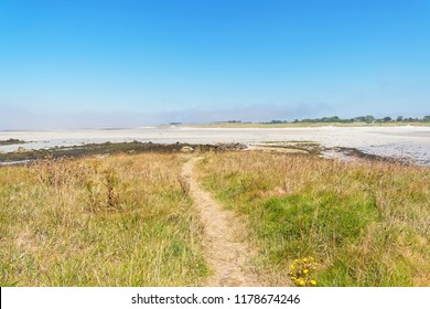 At low tide a narrow footpath leads of a small island to Plage Sainte-Marguerite, Landeda France