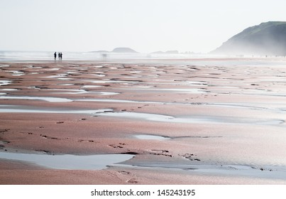 Low tide on the beach on a day of mist