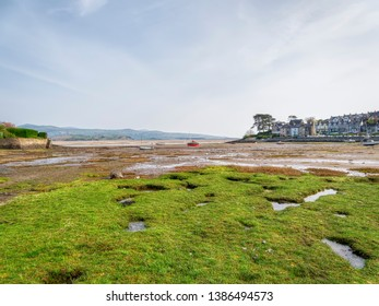 Low tide in the small harbour at Borth-y-Gest, near Porthmadog, at the end of a hazy spring day.