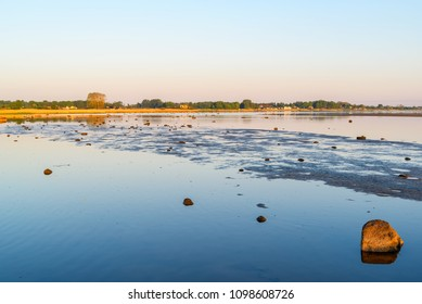 Low water levels at a shallow beach on a sunny morning. Location Utvalinge outside Angelholm in Sweden.