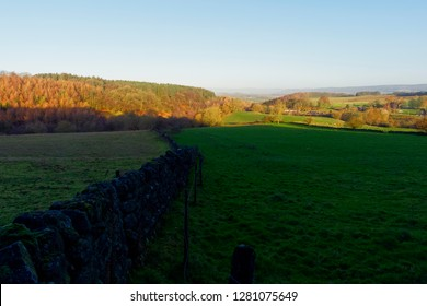 The low winter sun creates shadows across the fields and meadows of Derbyshire
