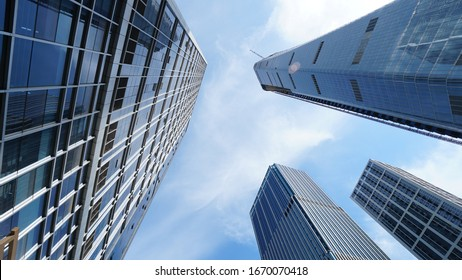 A low-angle shot of the mordern skyscrapers in the downtown and city buildings