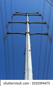 Low-angle view of steel support of overhead power transmission line