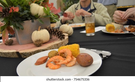 lowcountry boil on white plate of banquet table