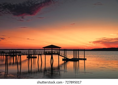 """""""Lowcountry Memories"""" Sunset on the Colleton River tidal estuary, prior to Hurricane Andrew wiping out most of these classic Lowcountry docks in 2016, many of which have now been replaced."""