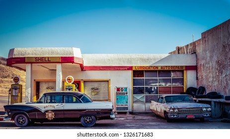 Lowell, Arizona / United States – November 25, 2018: 1955 Ford Fairlane Town Sedan police car parked at a Shell Station.