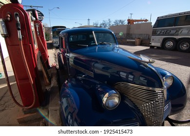 Lowell, Arizona, USA - December 13 2019: A 1939 Chevrolet Graham next to a restored vintage filling station.