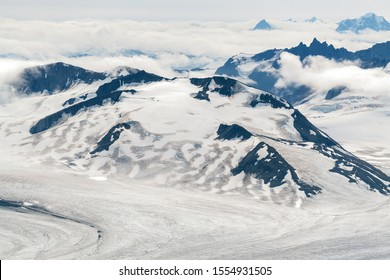 Lowell glacier and mountains in the clouds in Kluane National Park, Yukon, Canada