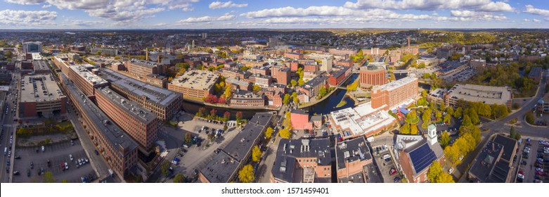 Lowell historic downtown, Canal, Marrimack River and historic Mills panorama aerial view in fall in Lowell, Massachusetts, MA, USA.