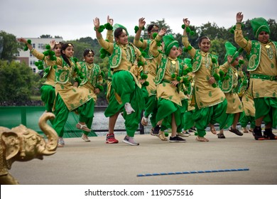LOWELL, MASSACHUSETTS/USA - SEPTEMBER 15, 2018: A group of children performing a traditional Bhangra dance from Punjab province at an outdoor stage during the annual India's Heritage Festival.