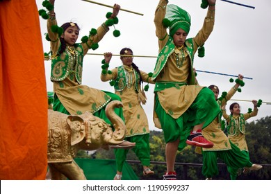 LOWELL, MASSACHUSETTS/USA - SEPTEMBER 15, 2018: A group of children performing a traditional Bhangra dance from Punjab at an outdoor stage during the annual India's Heritage Festival.