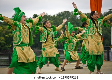 LOWELL, MASSACHUSETTS/USA - SEPTEMBER 15, 2018: A group of children performing a traditional Bhangra dance from Punjab on an outdoor stage during the annual India's Heritage Festival.