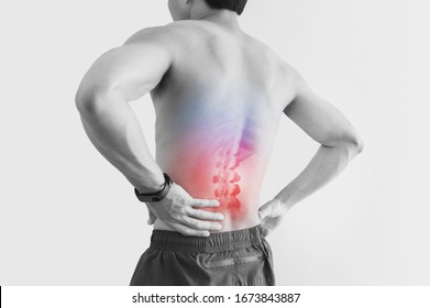 Lower back pain. Shirtless man touching his back with red highlight, on white background