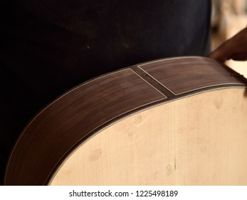 The lower body of a classical guitar.