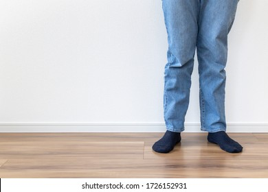 Lower body of a man wearing jeans