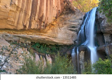Lower Calf Creek Falls in Escalante viewed over trees.