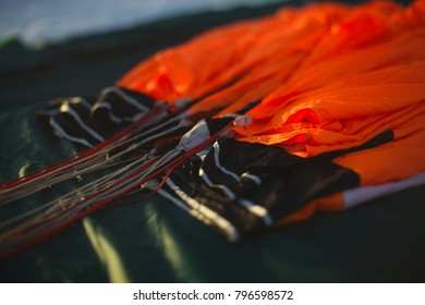 Lower edge of the canopy of the parachute for base jumping in the process of packing close-up. Parachute equipment. Tilt-shift effect.