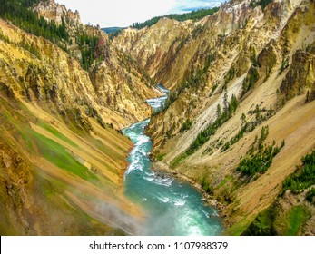 Lower Falls, most popular waterfall in Yellowstone, are located in head of the Grand Canyon in Yellowstone River. The yellow rocks gave name of Yellowstone National Park, Wyoming, United States.