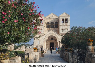 Lower Galilee/Israel - 11/9/2018: Beautiful monastery at the top of mount Tabor with Christian pilgrims. This is the alleged site of the Transfiguration of Christ, according to Christian belief