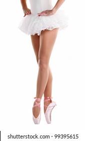 Lower half waist down image of ballerina dancing on pointe