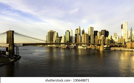 Lower Manhattan in the background of Brooklyn Bridge in a sunny morning, New York, United States