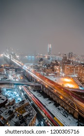 Lower Manhattan- Brooklyn Bridge and Manhattan Bridge Covered in Snow From Heavy Blizzard (Aerial Landscape)