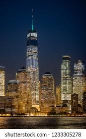 Lower Manhattan cityscape. Illuminated New York city buildings.