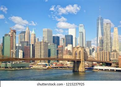 Lower Manhattan skyline with Brooklyn Bridge in New York City